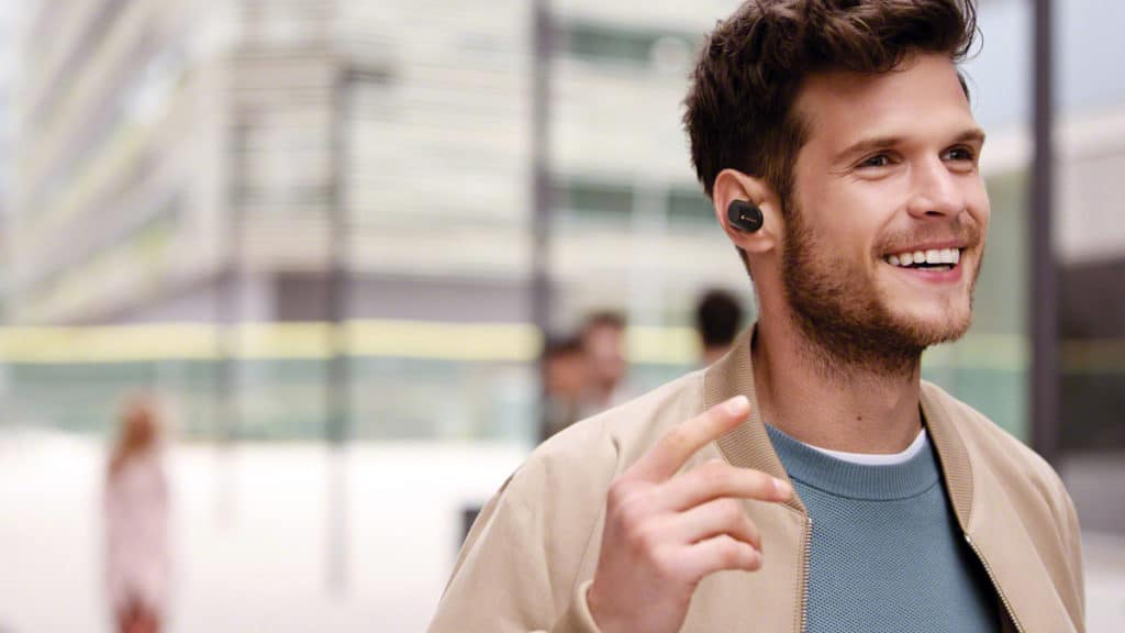 Man with noise cancelling sleep earbuds